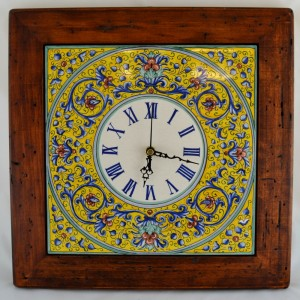 "CLOCK ""VOLUTE BLU FONDO GIALLO"" WITH WOODEN FRAME WORM-EATEN FROM CM. 34"