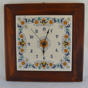 "CLOCK ""VOLUTE FIORI"" WITH WOODEN FRAM WORM-EATEN FROM CM. 28,5"